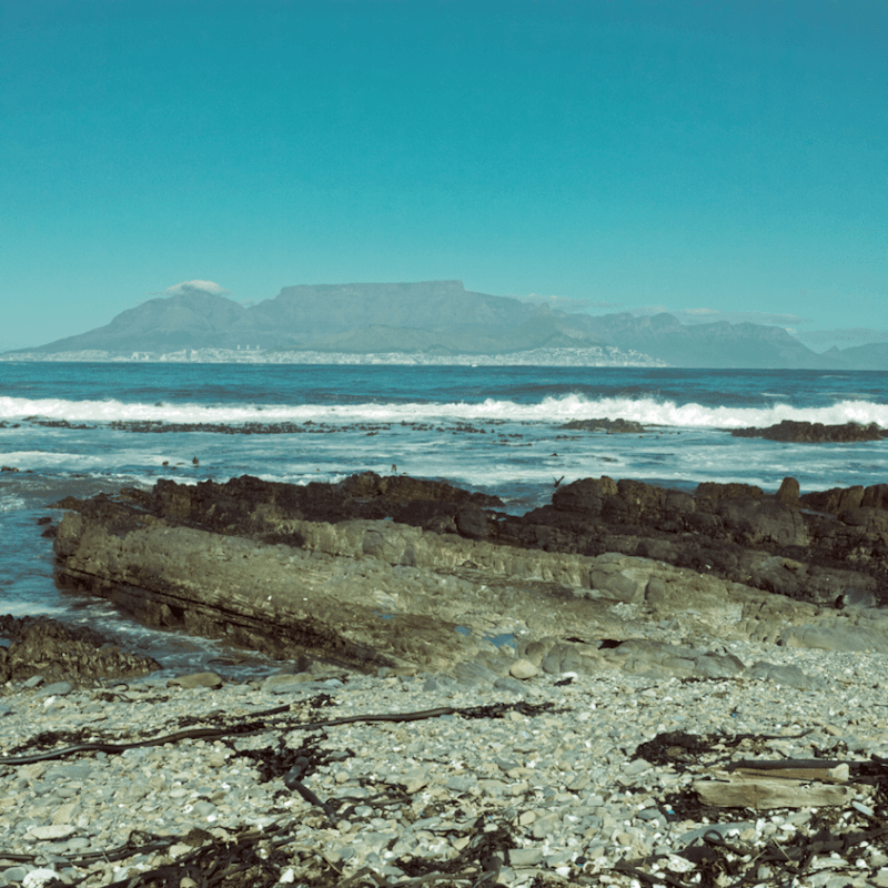 """A view from Robben Island to Cape Town, South Africa."""